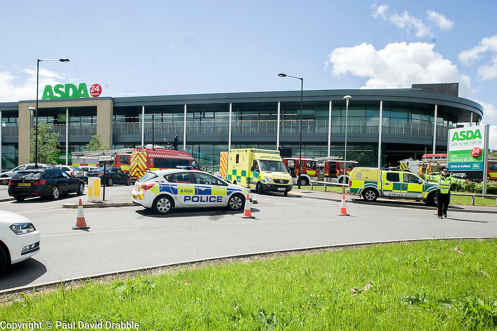 A Chemical spill in an Asda Superstore Car Park at Chaucer Road, Parson Cross, Sheffield resulted in customers being evacuated, road closures and some customers being sent home in Taxis. <br /> The incident was attended by Police, Firefighters, Decontamination Support and Ambulance crews on Friday Afternoon<br /> <br /> 29 May 2015<br />  Image &copy; Paul David Drabble <br />  www.pauldaviddrabble.co.uk