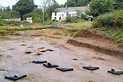 SAVEOCK WATER, CORNWALL, ENGLAND - AUGUST 02: General view of Mesolithic platform with votive pits cut into it on August 2, 2008 in Saveock Water, Cornwall, England. The site, with Saveock Water Field School in the background, is being excavated by Archaeologist Jacqui Wood and her team. (Photo by Manuel Cohen)
