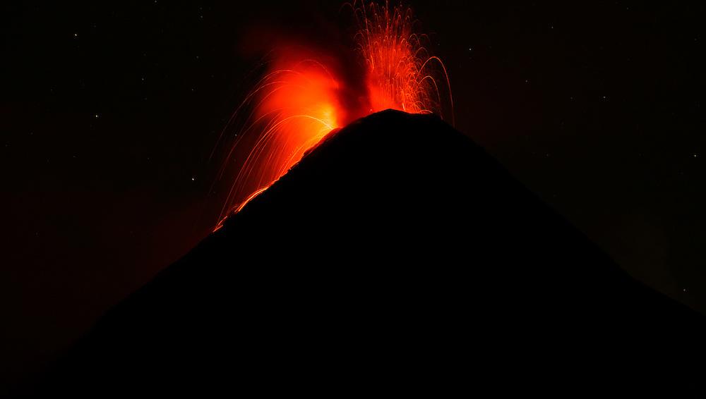 Volcano Fuego explodes at night and erupts lava and smoke, Volcan Fuego, Guatemala.