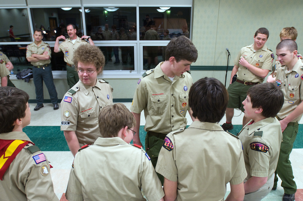 David Neri, left, and senior patrol leader David Ford inspect the troop's uniforms. A regular Monday, March 1, 2010 meeting of Boy Scout Troop 4 at St. Agnes Catholic Church on Newburg Road. (Photo by Brian Bohannon)