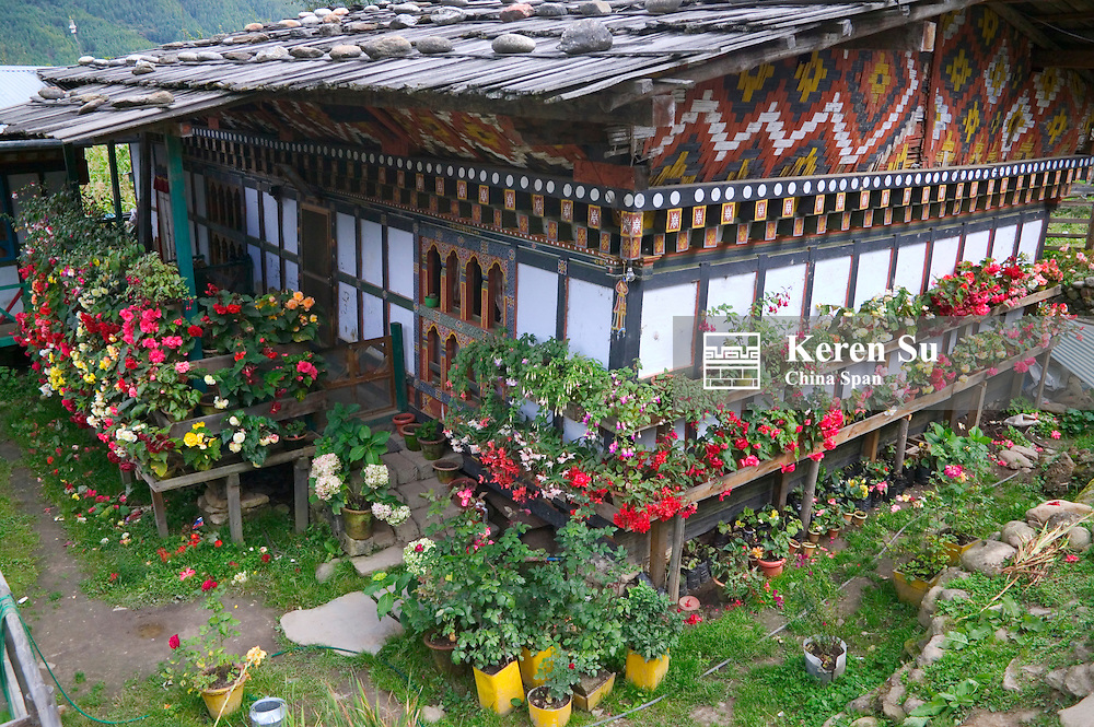 Traditional residential house with flower pots, Bumthang, Bhutan