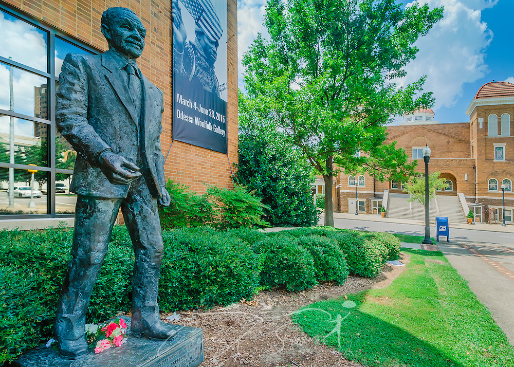 A statue of Civil Rights activist Rev. Fred Shuttlesworth stands in front of the Birmingham Civil Rights Institute, July 12, 2015, in Birmingham, Alabama. Since the institute opened in 1992, more than 2 million people have visited. (Photo by Carmen K. Sisson/Cloudybright)