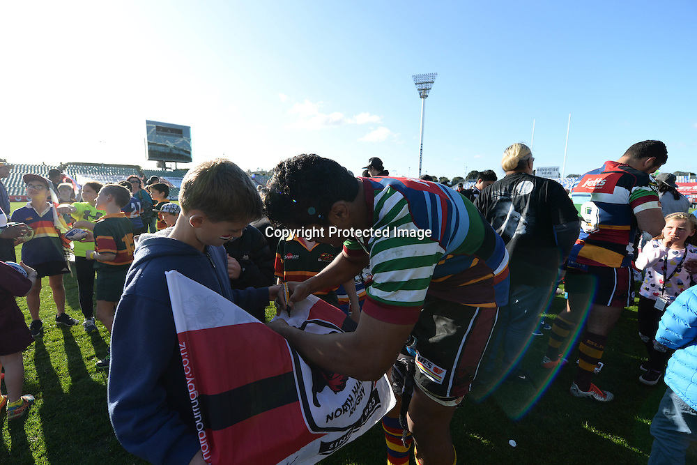 North Harbour players oblige to fans' autograph requests after their 28-20 victory over Counties Manukau during the ITM Cup match between North Harbour and Counties Manukau. QBE Stadium, Auckland, New Zealand. Saturday 12 September 2015. Copyright Photo: Raghavan Venugopal / www.photosport.nz