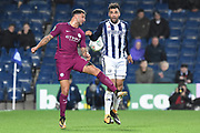 Manchester City defender Kyle Walker (2) challenges West Bromwich Albion striker Hal Robson-Kanu (4) 1-2 during the EFL Cup match between West Bromwich Albion and Manchester City at The Hawthorns, West Bromwich, England on 20 September 2017. Photo by Alan Franklin.