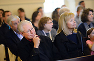 Audience members listen to speakers during the annual Candlelight Vigil for crime victims Tuesday April 4, 2017 at Friends Meetinghouse in Newtown, Pennsylvania. NOVA (Network of Victims Assistance) hosted the event in which survivors spoke of their experiences as victims of crime. (Photo by William Thomas Cain)