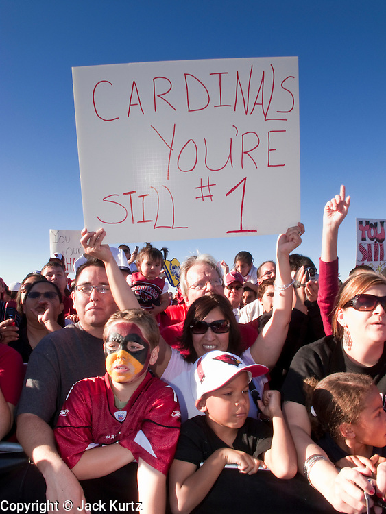 Feb 2, 2009 -- PHOENIX, AZ: People hold up signs welcoming home the Arizona Cardinals. More than 4,000 people came to Sky Harbor Airport in Phoenix to welcome home the Arizona Cardinals, the city's NFL team. The Cardinals lost the Superbowl to the Pittsburgh Steelers 27 - 23.   Photo By Jack Kurtz / ZUMA Press