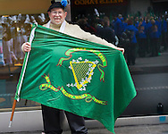 March 16, 2013 - New York, NY, U.S. - Man holding Sons of Erin flag, as he gets ready to march in the  252nd annual NYC St. Patrick's Day Parade.