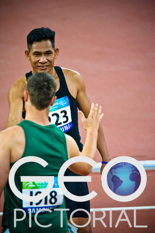 "Oscar Pistorius of South Africa with Vanna Kim of Cambodia after the men's T44 100m heats on Day 2 of the 2008 Beijing 2008 Paralympic Games at the National ""Bird's Nest"" Stadium in Beijing, China on the 8th September 2008;"