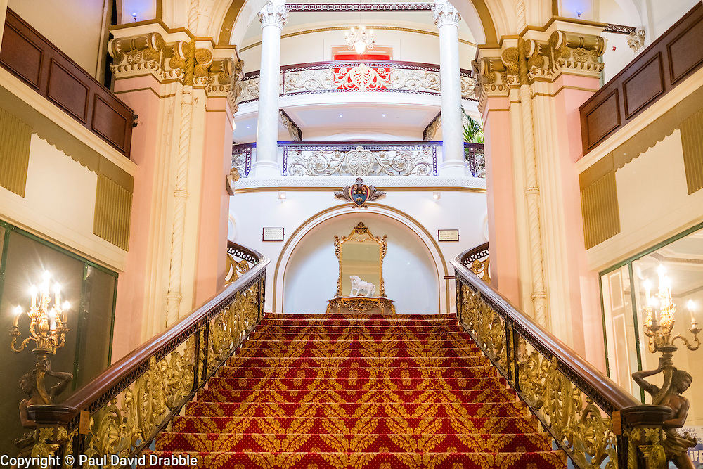 Man staircase in the Grand Hotel A Grade II listed building Dominating Scarborough South Bay. When completed in 1867 it was one of the largest hotels in the world, as well as one of the first giant purpose-built hotels in Europe. The hotel is in the shape of a 'V' in honour of Queen Victoria and was designed around the theme of time: <br /> 4 towers to represent the seasons, <br /> 12 floors for the months of the year, <br /> 52 chimneys symbolise the weeks, <br /> originally there were 365 bedrooms - one for each day of the year. <br /> As Scarborough was a famous 'Spa Town' in its heyday the Grand hotels baths included an extra pair of taps so guests could wash in seawater as well as fresh water.<br /> The hotel was badly damaged when the German Navy bombarded the town in 1914.<br /> Three blue plaques outside mark where the novelist Anne Brontë died in 1849, the contribution of the RAF trainees stationed at the hotel during the Second World War, and the original opening of the building.<br />  12 September 2015<br />  Copyright Paul David Drabble<br />  www.pauldaviddrabble.photoshelter.comom