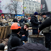 December 18, 2013 - Kiev, Ukraine: Pro-EU demonstrators try to stay warm beside a fire in Independence Square.<br /> On the night of 21 November 2013, a wave of demonstrations and civil unrest began in Ukraine, when spontaneous protests erupted in the capital of Kiev as a response to the government's suspension of the preparations for signing an association and free trade agreement with the European Union. Anti-government protesters occupied Independence Square, also known as Maidan, demanding the resignation of President Viktor Yanukovych and accusing him of refusing the planned trade and political pact with the EU in favor of closer ties with Russia.<br /> After a days of demonstrations, an increasing number of people joined the protests. As a responses to a police crackdown on November 30, half a million people took the square. The protests are ongoing despite a heavy police presence in the city, regular sub-zero temperatures, and snow. (Paulo Nunes dos Santos/Polaris)
