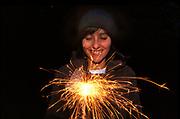 Girl holding sparkler, UK 2005