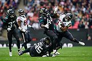 Jacksonville Jaguars Linebacker Myles Jack (44)  tackles Houston Texans Running Back Carlos Hyde (23) during the International Series match between Jacksonville Jaguars and Houston Texans at Wembley Stadium, London, England on 3 November 2019.