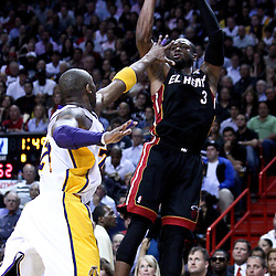 March 10, 2011; Miami, FL, USA; Miami Heat shooting guard Dwyane Wade (3) shoots over Los Angeles Lakers shooting guard Kobe Bryant (24) during the fourth quarter at the American Airlines Arena. The Heat defeated the Lakers 94-88.   Mandatory Credit: Derick E. Hingle