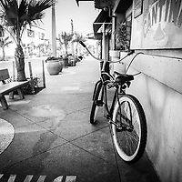 Black and white photo of California beach crusier bike in Newport Beach California. Taken at Cabo Cantina on Main Street on Balboa Peninsula in Orange County Southern California. Image Copyright © Paul Velgos All Rights Reserved.