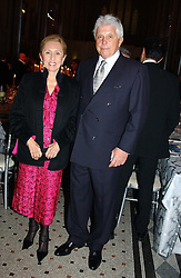 ROBERT & CHANTAL MILLER at The Magic of Winter ball in aid of the charity KIDS held at The Royal Courts of Justice, London on 2nd Ferbruary 2005.<br />