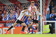 Brentford defender John Egan (14)  scoring 1-0 during the EFL Sky Bet Championship match between Brentford and Ipswich Town at Griffin Park, London, England on 13 August 2016. Photo by Matthew Redman.