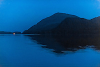 Night scene of a ship passing, Nakwasina Sound,  Inside Passage, Southeast Alaska USA.
