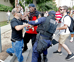 "State troopers jump in as members of the Loyal White Knights of the Ku Klux Klan from Pelham, N.C., clash with counter demonstrators at the State House Saturday, July 18, 2015 in Columbia. zlaup ""Confederate Flag"""