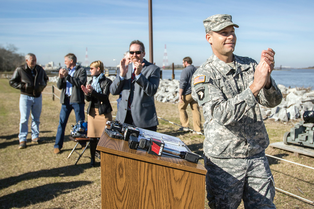 Col. Thomas Tickner, U.S. Army Corp of Engineers Savannah District Commander, applauds after a ceremonial canon firing, Thursday, Jan. 29, 2015, to start the the recovery of the Confederate ironclad ship CSS Georgia in Savannah, Ga. The recovery of the ship marks the beginning of the construction phase of the Savannah Harbor Expansion Project. (GPA Photo/Stephen B. Morton)