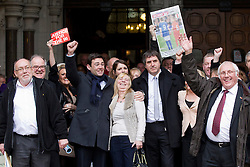 © Licensed to London News Pictures. 19/12/2012. London, UK. The families of those killed in the 1989 Hillsborough disaster are seen outside the Royal Courts of Justice in London after the original accidental death ruling was quashed by a judge today 19/12/12). The ruling on the disaster, in which 96 football fans were crushed to death during an FA Cup semi final between Liverpool and Nottingham Forest, opens the way for a new inquest. Photo credit: Matt Cetti-Roberts/LNP