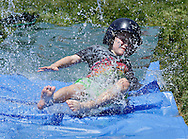 Mackay Lynch slides through water during the SUNY Orange baseball camp in Middletown on Thursday, July 18, 2013. The camp started on Monday and ends on Friday.