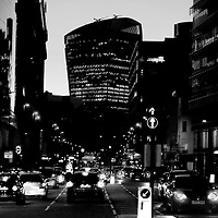 The RBS bank to the left and the 20 Fenchurch Street skyscraper in the background of the Whitechapel Road during the evening in London.