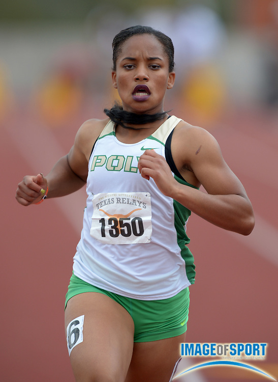 Mar 28, 2014; Austin, TX, USA; Jade Lewis of Long Beach Poly runs 12.14 in a girls 100m heat in the 87th Clyde Littlefield Texas Relays at Mike A. Myers Stadium.