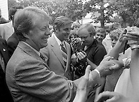 1976, Georgia, USA --- Democratic presidential candidate Jimmy Carter (left) and vice presidential candidate Walter Mondale (center) shakes hands with supporters during their campaign for the 1976 presidential election. --- Image by © Owen Franken/Corbis