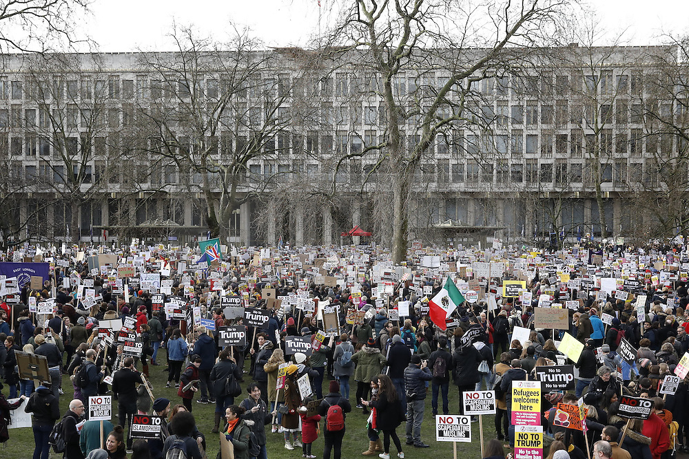 © Licensed to London News Pictures. 04/02/2017. London, UK. Protestors gather outside the US Embassy during a demonstration against U.S President Donald Trump's Executive Order banning refugees and immigrants from a number of Muslim-majority countries. Protestors join campaign groups including Stop the War, Stand up to Racism, Muslim Association of Britain, in a march from the U.S Embassy in London to Downing Street. Photo credit: Peter Macdiarmid/LNP