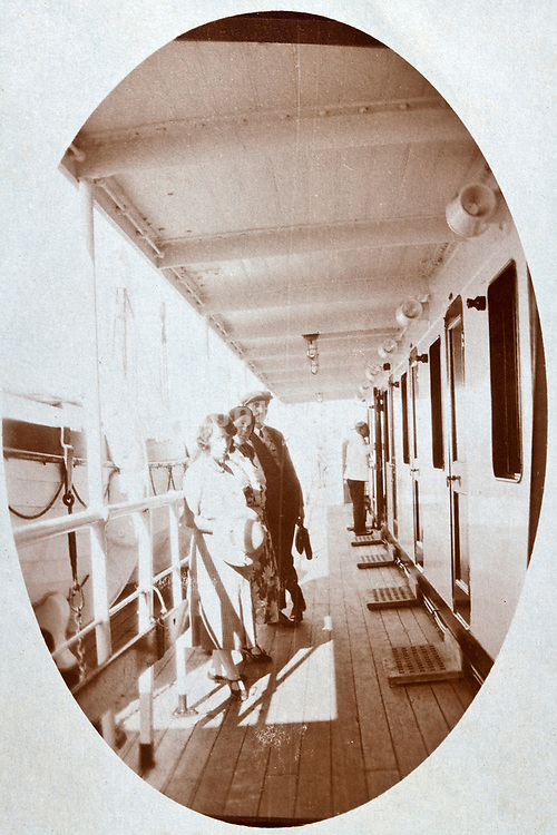 people on the cabin deck of a large cruise passenger ship 1930s