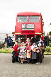 Pictured: Billy Letford (dark hair, beard, blue jeans, scarf), Caro Ramsay (Blond hair, red shirt) , Martin Stewart (Rust coloured jumper), Pamala Butchart (colourful dress), Lari Don (long hair, Red jacket), Chris Brookmyre (bald, dark jacket) Graeme Macrae Burnet (tartan scarf), Christine de Luca (Tartan jacket), Mark Greenway (chef) and Debi Gliori (yellow patterned skirt, pick scarf)<br /> <br /> Ten Scottish authors gathered in Edinburgh on a vintage red bus with Book Week Scotland 2016 as the final destination which is being held between November 21 and 27 2016<br /> <br /> Ger Harley | EEm 5 October 2016