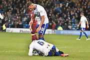 Bury Defender, Reece Brown checks on team mate Bury Midfielder, Kelvin Etuhu during the The FA Cup third round match between Bury and Bradford City at Gigg Lane, Bury, England on 9 January 2016. Photo by Mark Pollitt.