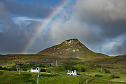 Morning rainbow seen over farms at Digg village, near Staffin, Isle of Skye, Scotland, UK, Europe.