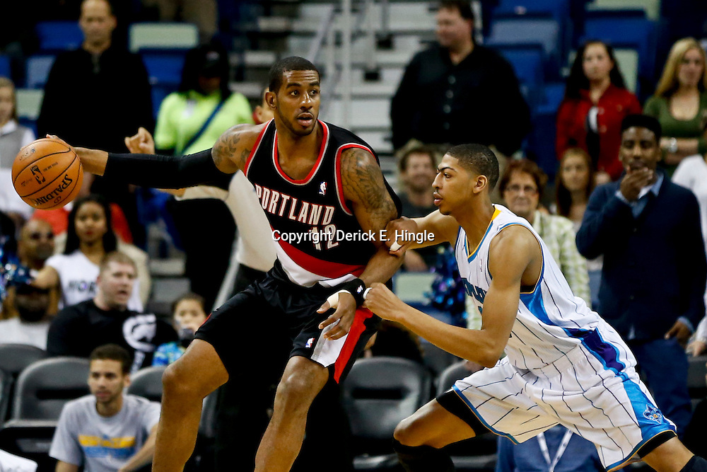 Feb 13, 2013; New Orleans, LA, USA; Portland Trail Blazers power forward LaMarcus Aldridge (12) against New Orleans Hornets power forward Anthony Davis (23) during the first quarter of a game at the New Orleans Arena. Mandatory Credit: Derick E. Hingle-USA TODAY Sports