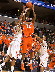 Clemson forward/center Raymond Sykes (12) shoots over Virginia forward Jamil Tucker (12).  The Virginia Cavaliers defeated the #12 ranked Clemson Tigers in overtime 85-81 at the John Paul Jones Arena on the Grounds of the University of Virginia in Charlottesville, VA on February 15, 2009.