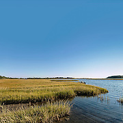 A saltwater marsh in Niantic, East Lyme, Connecticut, USA, known to residents as the backwaters, is a nesting ground for ospreys as well as a popular spot for boating and other water sports, September 2007.