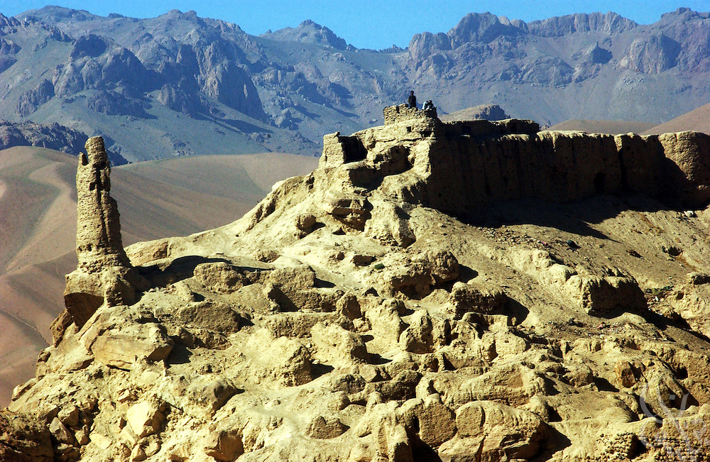 The ruins of an ancient fortress stand atop an isolated mountain peak in the Baba mountain range June 17, 2002 near Bamiyan, Afghanistan.