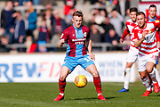 Scunthorpe United forward George Thomas (18), on loan from Leicester City, controls the ball during the EFL Sky Bet League 1 match between Scunthorpe United and Doncaster Rovers at Glanford Park, Scunthorpe, England on 23 February 2019.