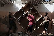 Gaza Strip, Gaza City: Palestinians are seen as they recover a closet from their destroyed house by Israeli irstrike Al-Shati Camp in Gaza City on August 2, 2014. ALESSIO ROMENZI