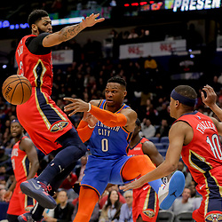 Dec 12, 2018; New Orleans, LA, USA; Oklahoma City Thunder guard Russell Westbrook (0) passes as New Orleans Pelicans guard Tim Frazier (10) and forward Anthony Davis (23) defend during the first quarter at the Smoothie King Center. Mandatory Credit: Derick E. Hingle-USA TODAY Sports