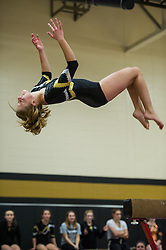 Ellie VanBuskirk dismounts from beam