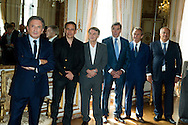 """Michel Drucker and (LtoR) François Pirette, Salvatore Adamo, Eddy Merckx, Jacky Ickx, Eric-Emmanuel Schmitt at the ceremony who Michel Drucker was awarded at  the title of Commander of the Order of the Crowne at the Palace Egmont"""" at Brussels, 2014 in Brussels, Belgium."""