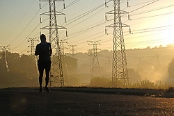 JOHANNESBURG, SOUTH AFRICA - MAY 10: A runner out exercising in Randburg during lockdown level 4 on May 10, 2020 in Johannesburg, South Africa. According to media reports, during lockdown level 4 people are allowed to exercise. Guidelines allow for cycling, running and walking as examples and must be within a 5km radius of their residences between 6:00 am – 9:00 am. (Photo by Dino Lloyd)
