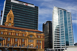 The Auckland Ferry Building surrounded by the central business district, Auckland, New Zealand