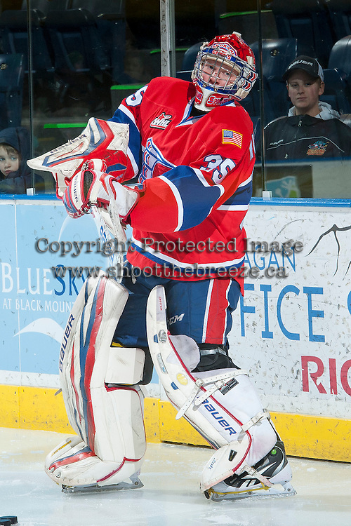 KELOWNA, CANADA -JANUARY 29: Eric Williams G #35 of the Spokane Chiefs clears the puck from the behind the net against the Kelowna Rockets on January 29, 2014 at Prospera Place in Kelowna, British Columbia, Canada.   (Photo by Marissa Baecker/Getty Images)  *** Local Caption *** Eric Williams;