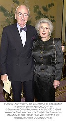LORD & LADY YOUNG OF GRAFFHAM at a reception in London on 8th April 2002.OYR 48