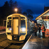 John Argo and fellow traveller Pat Ruddy pictured at ScotRail's Dunkeld & Birnam railway station with other passengers as they board the 07.39 train to Edinburgh…01.12.16<br />Picture by Graeme Hart.<br />Copyright Perthshire Picture Agency<br />Tel: 01738 623350  Mobile: 07990 594431