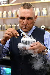 EDITORIAL USE ONLY<br /> Vinnie Jones serve customers a 'gunpowder' coffee, specially created by Bompas and Parr at the TimberYard in London's Seven Dials, which has been transformed into a 1960s New Orleans style cafe to celebrate the launch of Mafia III, a new mobster themed open world action-adventure game created by 2K UK.
