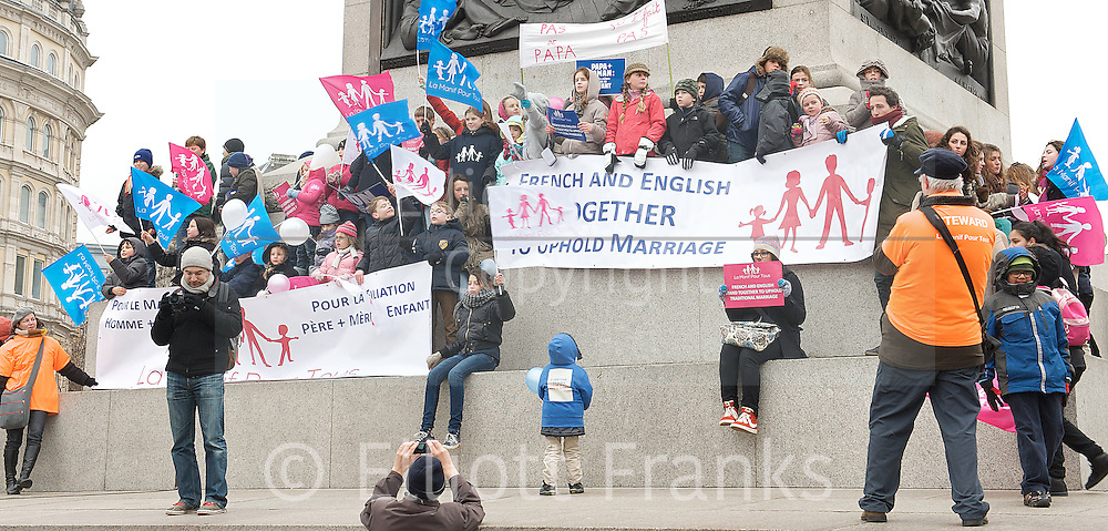 Equal marriage - protest<br /> Trafalgar Square, London, Great Britain <br /> 24th  March 2013 <br /> <br /> Rally, organised by French group La Manif pour Tous, protests against same-sex marriage and 'defend' traditional marriage which the group claims is being 'sacrificed for the sake of politically-correct fashion.' A counter-protest, organised by the Secular Europe Campaign<br /> <br /> <br /> Photograph by Elliott Franks