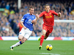 Everton's James McCarthy is challenged by Liverpool's Lucas Leiva - Photo mandatory by-line: Dougie Allward/JMP - Tel: Mobile: 07966 386802 23/11/2013 - SPORT - Football - Liverpool - Merseyside derby - Goodison Park - Everton v Liverpool - Barclays Premier League